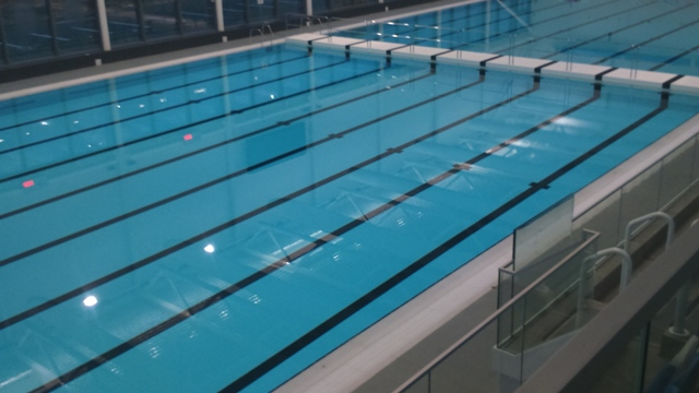 Main pool moveable floor elite tiling ltd for Movable swimming pool floor australia
